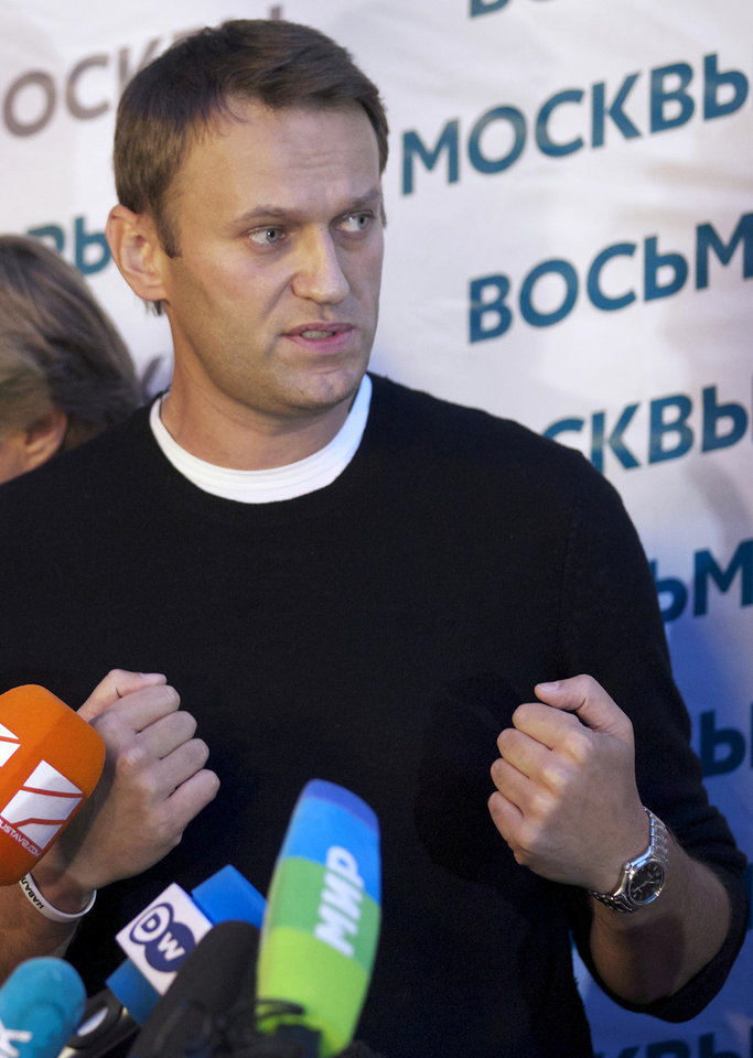 Photo - Russian opposition leader Alexei Navalny gestures as he speaks to the media at his headquarters in Moscow, Russia, Sunday, Sept. 8, 2013.Two exit polls in Moscow's mayoral election are predicting a stronger showing than expected for opposition leader Alexei Navalny. Sunday's mayoral election is a potentially pivotal contest that has energized the small opposition in ways that could pose a risk to the Kremlin in the days and years ahead. (AP Photo/Alexander Zemlianichenko)
