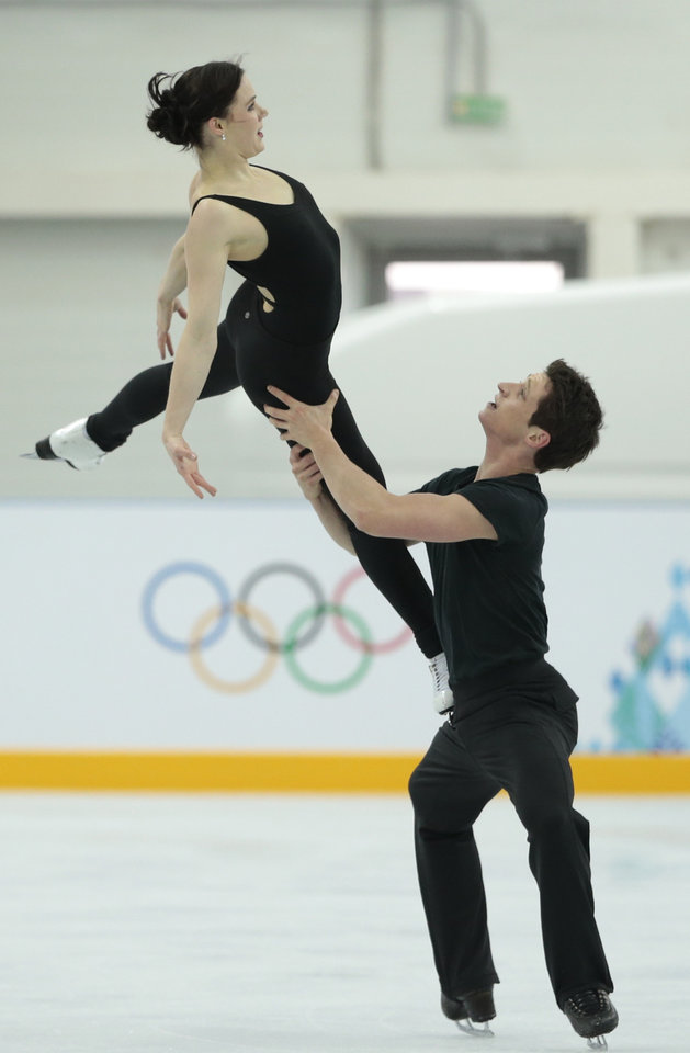 Photo - Canada's Tessa Virtue and Scott Moir skate at the figure skating practice rink ahead of the 2014 Winter Olympics, Wednesday, Feb. 5, 2014, in Sochi, Russia. (AP Photo/Ivan Sekretarev)