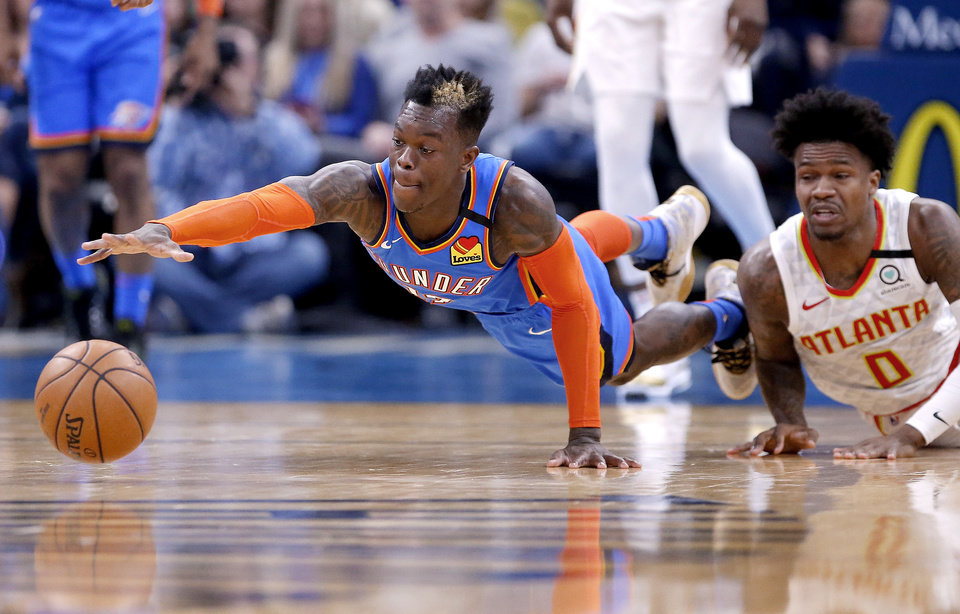 Photo - Oklahoma City's Dennis Schroder (17) tries to get a loose ball next to Atlanta's Jeff Teague (0) during the NBA basketball game between the Oklahoma City Thunder and the Atlanta Hawks at the Chesapeake Energy Arena in Oklahoma City,Friday, Jan. 24, 2020.  [Sarah Phipps/The Oklahoman]