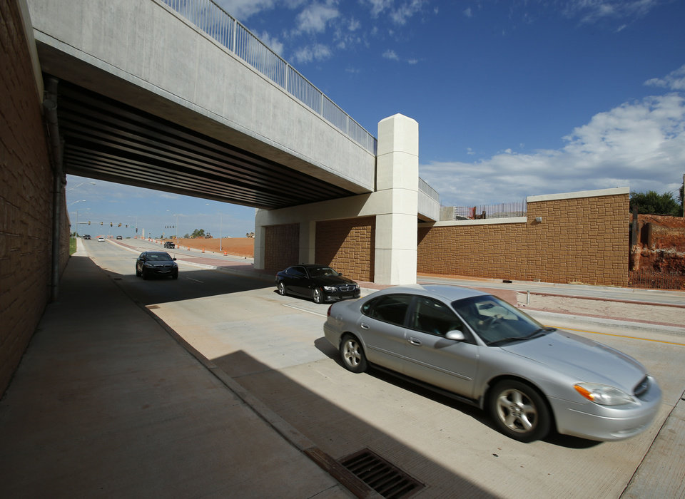 Photo - Traffic moves under the recently completed railroad underpass on Robinson Street in September. OKLAHOMAN ARCHIVES  STEVE SISNEY