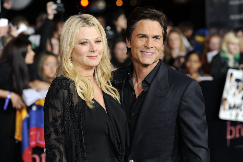 "Rob Lowe, right, and wife Sheryl Berkoff arrive at the world premiere of ""The Twilight Saga: Breaking Dawn - Part 1"" on Monday, Nov. 14, 2011, in Los Angeles. (AP Photo/Chris Pizzello) ORG XMIT: CASH200"