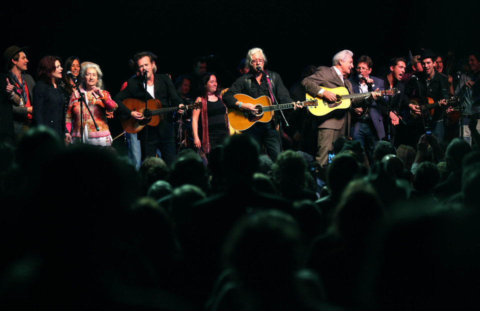 "All the peformers of the Woody Guthrie Centennial Concert including Taylor Hanson, Rosanne Cash, Nora Guthrie, John Mellencamp, Arlo Guthrie, Del McCoury, Tim O'Brien and Hanson perform ""This Land is Your Land"" at the Brady Theater Saturday March 10, 2012.  (AP Photo/Christopher Smith, Tulsa World) ORG XMIT: OKTUL111"