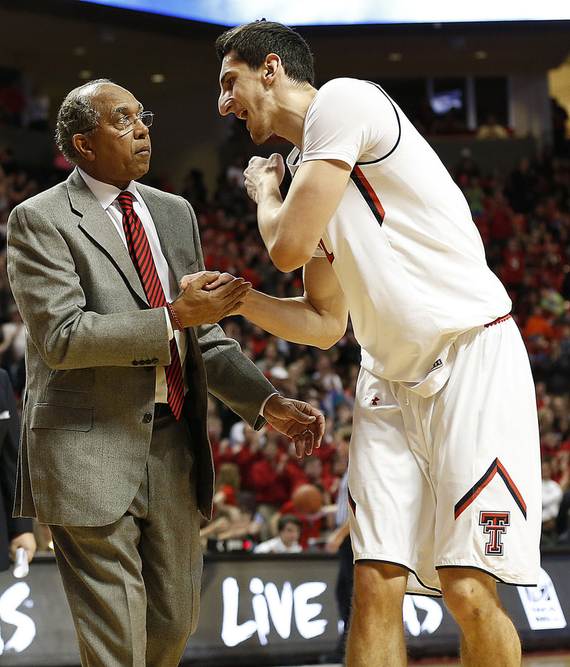 Photo - Texas Tech coach Tubby Smith, left, talks with Dejan Kravic during their NCAA college basketball game against Baylor in Lubbock, Texas, Wednesday, Jan, 15, 2014. (AP Photo/Lubbock Avalanche-Journal, Tori Eichberger) ALL LOCAL TV OUT
