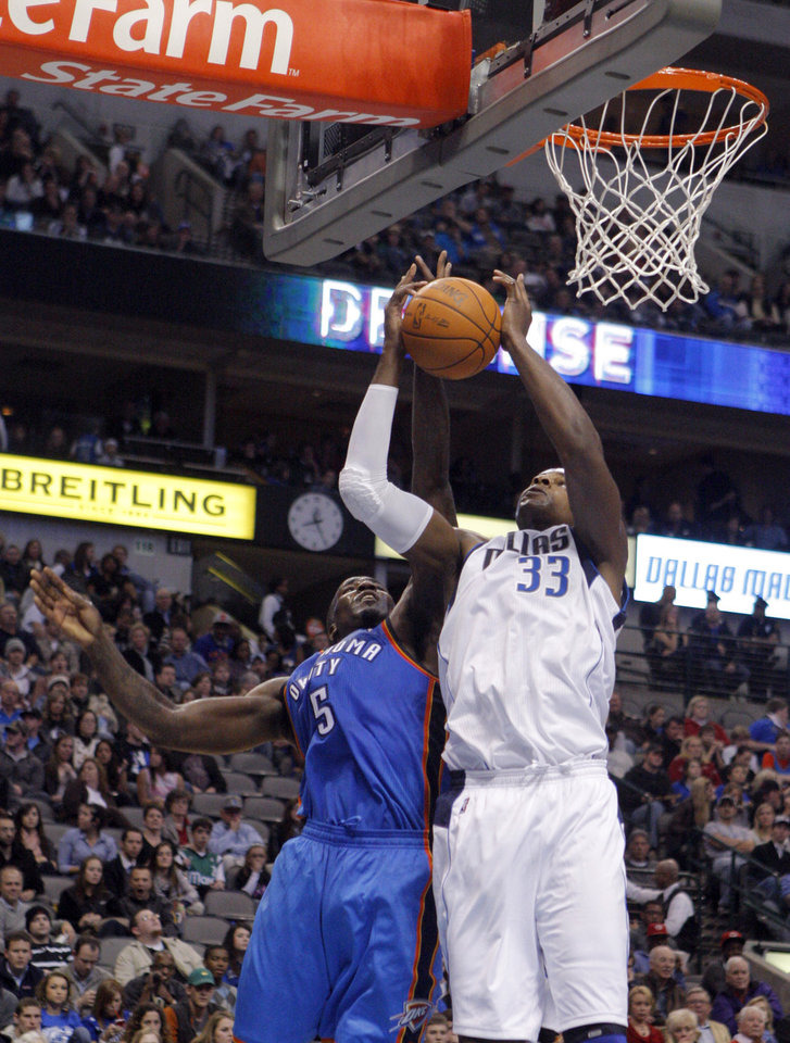 Photo - Oklahoma City's Kendrick Perkins (5) fights Dallas' Brendan Haywood (33) for a rebound during the pre season NBA game between the Dallas Mavericks and the Oklahoma City Thunder at the American Airlines Center in Dallas, Sunday, Dec. 18, 2011. Photo by Sarah Phipps, The Oklahoman