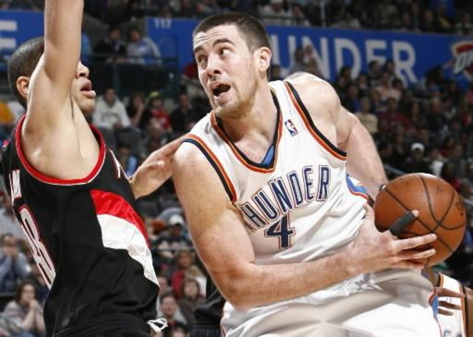 Oklahoma City's Nick Collison (4) tries to get past the defense of Portland's Nicolas Batum (88) during the NBA basketball game between the Oklahoma City  Thunder and the Portland Trail Blazers at the Ford Center in Oklahoma City, Friday, February 6, 2009. By Nate Billings