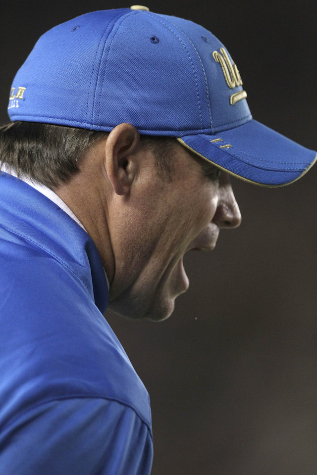 Photo -   UCLA head coach Jim Mora argues with the referees after a call against California during the first half of an NCAA college football game in Berkeley, Calif., Saturday, Oct. 6, 2012. (AP Photo/Tony Avelar)