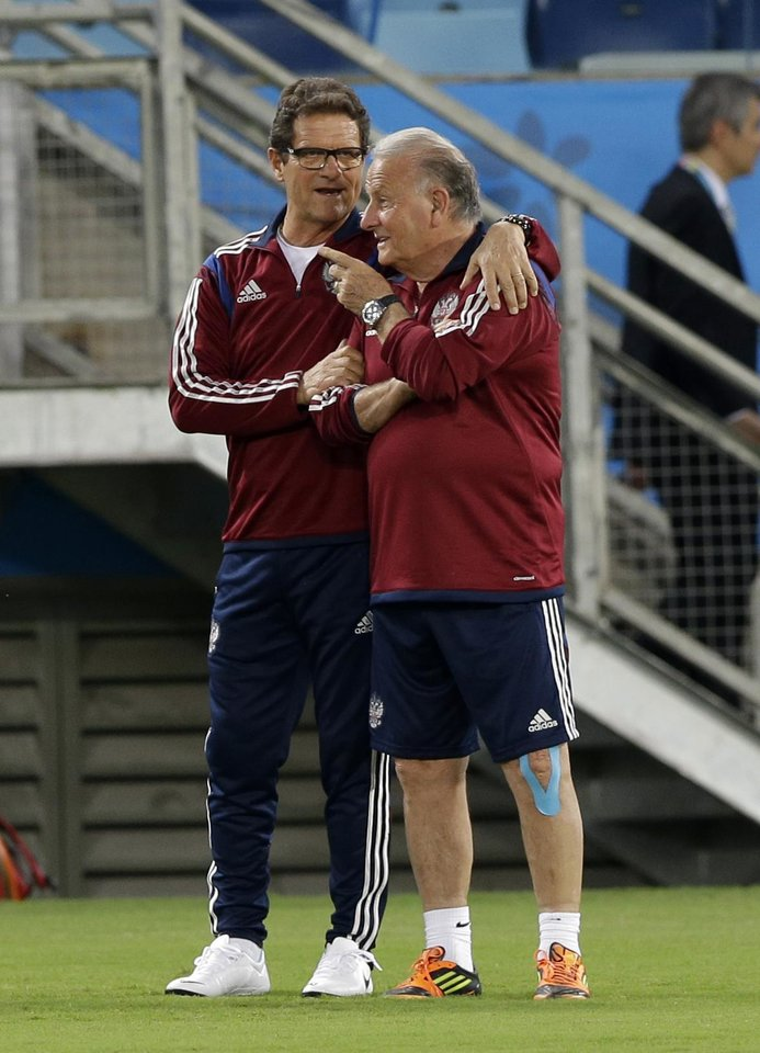 Photo - `Russian national soccer team coach Fabio Capello, left, talks with assistant coach Italo Galbiati during an official training session the day before the group H World Cup soccer match between Russia and South Korea at the Arena Pantanal in Cuiaba, Brazil, Monday, June 16, 2014. (AP Photo/Lee Jin-man)