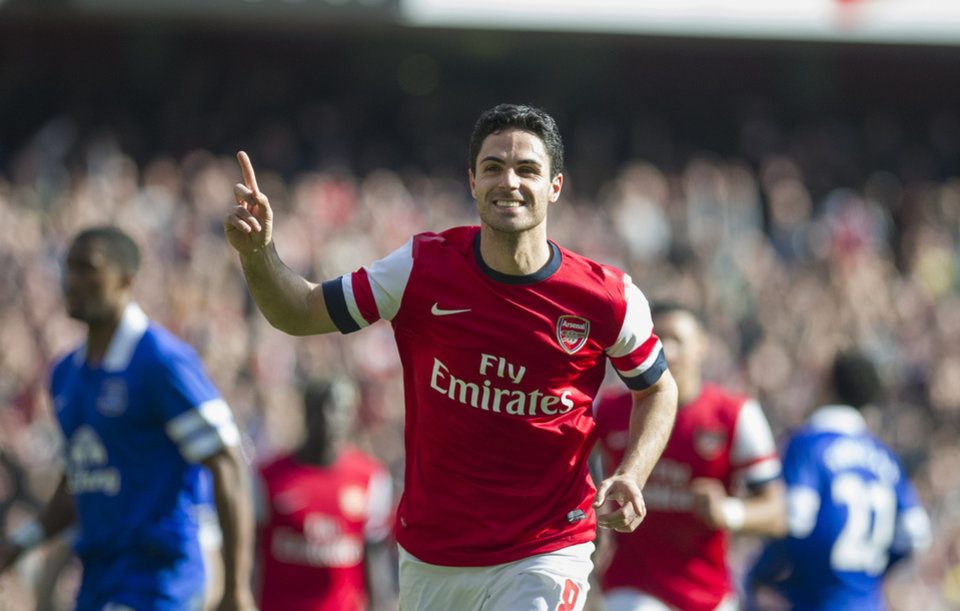 Photo - Arsenal's Mikel Arteta celebrates, after scoring against Everton, during their FA Cup quarterfinal soccer match, at Emirates Stadium, in London, Saturday, March 8, 2014. (AP Photo/Bogdan Maran)