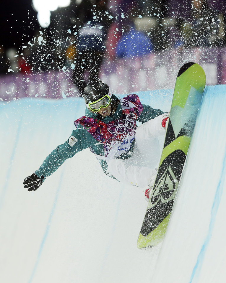 Photo - Australia's Torah Bright competes during the women's snowboard halfpipe final at the Rosa Khutor Extreme Park, at the 2014 Winter Olympics, Wednesday, Feb. 12, 2014, in Krasnaya Polyana, Russia. (AP Photo/Sergei Grits)