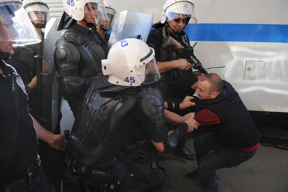Photo - Riot police detain a protester as several hundred of people protest against the government in Soma, Turkey, Friday, May 16, 2014. A Turkish mining company defended its safety record Friday, four days after over 250 people died in an underground accident at its coal mine in western Turkey.(AP Photo/Emre Tazegul)