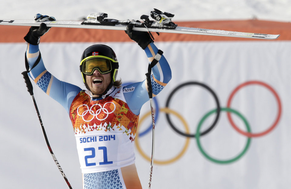 Photo - Norway's Kjetil Jansrud celebrates after his run in the men's super-G at the Sochi 2014 Winter Olympics, Sunday, Feb. 16, 2014, in Krasnaya Polyana, Russia.(AP Photo/Gero Breloer)