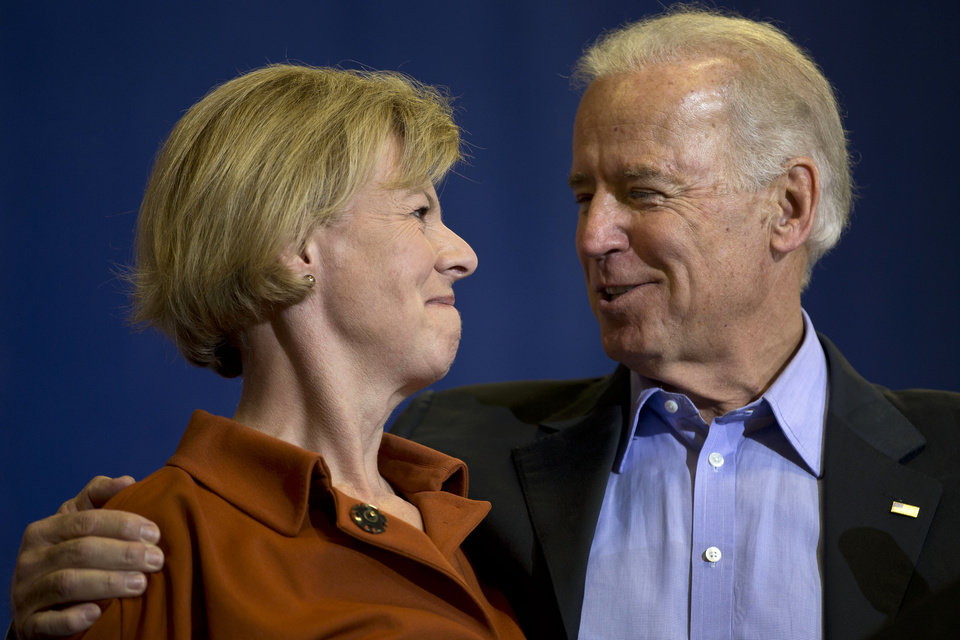 Vice President Joe Biden embraces Wisconsin Democratic Senate candidate, Rep. Tammy Baldwin, D-Wis. during a campaign rally at Aldrich Middle School, Friday, Nov. 2, 2012, in Beloit, Wis. (AP Photo/Matt Rourke)