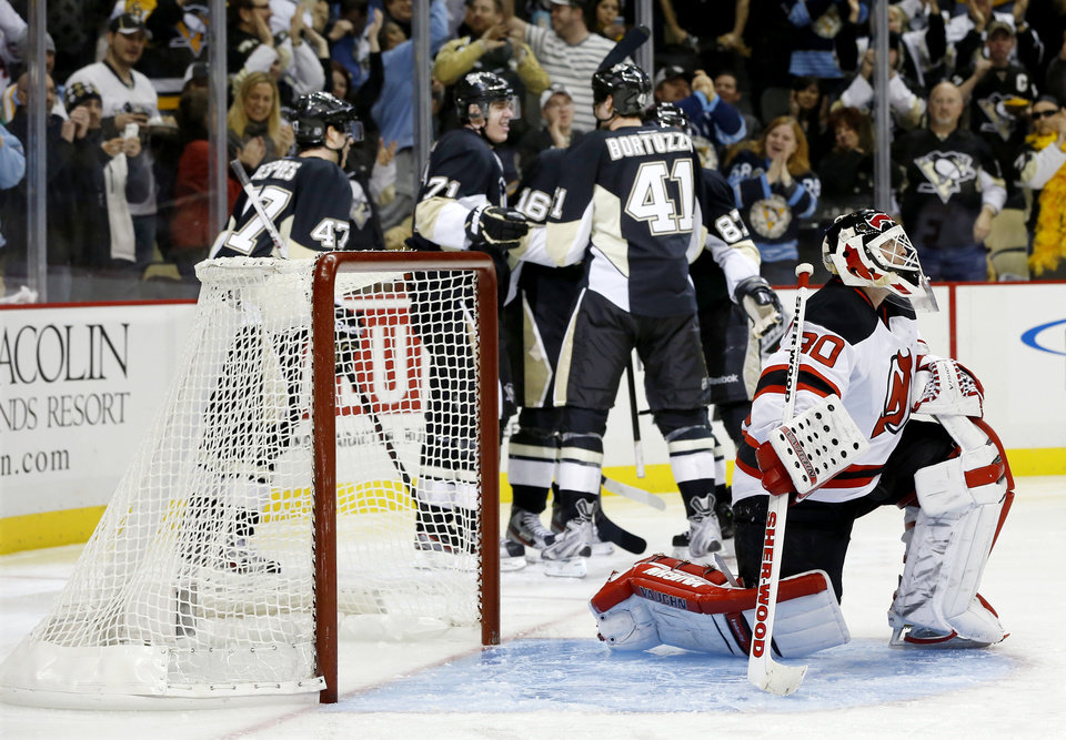 Pittsburgh Penguins players celebrate after\' Brandon Sutter scored past New Jersey Devils goalie Martin Brodeur (30) in the second period of an NHL hockey game on Saturday, Feb. 2, 2013 in Pittsburgh. (AP Photo/Keith Srakocic)