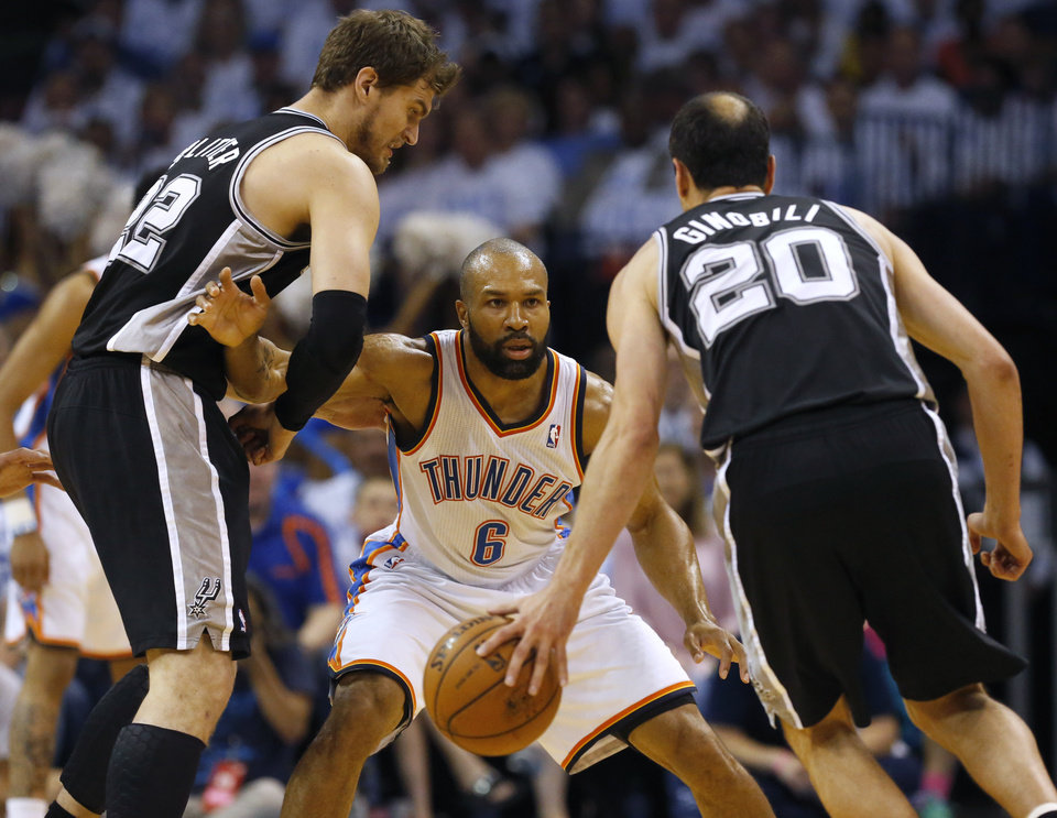 Photo - Oklahoma City Thunder guard Derek Fisher (6) defends between San Antonio Spurs guard Manu Ginobili (20) and Tiago Splitter during the first half of Game 6 of the Western Conference finals NBA basketball playoff series ,in Oklahoma City, Saturday, May 31, 2014. (AP Photo/Sue Ogrocki)