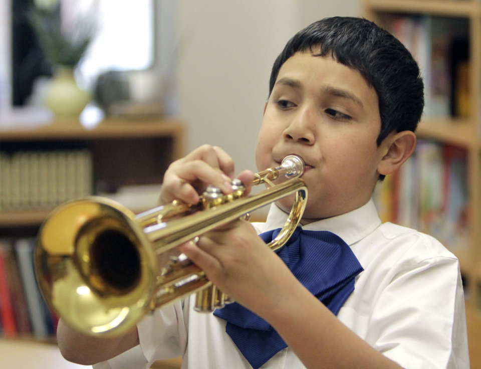 Kevin Cortez plays the trumpet during a Mariachi class at Fillmore Elementary School in Oklahoma City, OK, Tuesday, Nov. 22, 2011. By Paul Hellstern, The Oklahoman