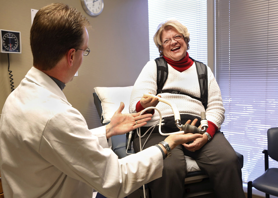 Pam Golden of Longtown  laughs during a chat with her cardiologist, Dr. Douglas Horstmanshof, in an examining room during Golden's visit  to Horstmanshof's office in Oklahoma City this week.  Golden had a LVAD (left ventricular assistance device) implanted in her body to improve her circulation system.  Photographed at  Integris Baptist Hospital on Monday, Jan. 14, 2013.     Photo by Jim Beckel, The Oklahoman