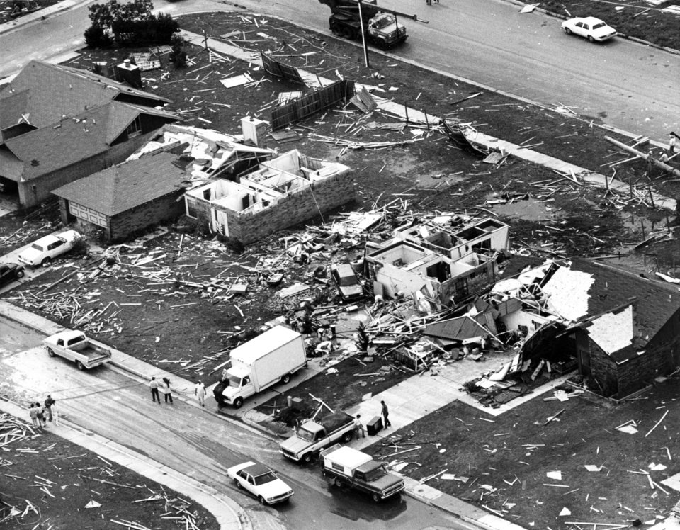 Photo - TORNADO DAMAGE: Aerial view of a few of the damaged/destroyed homes in Edmond's Fairfield housing addition caused by the tornado which struck Thursday night, 5/8/86.  Area struck hardest located just west of the Santa Fe/15th Street intersection in southwest Edmond. Staff photo by Al McLaughlin taken 5/9/86. File:  Storms/Tornado/State/Edmond/May 8, 1986