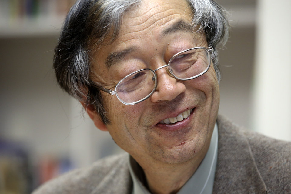 Photo - Dorian S. Nakamoto smiles during an interview with the Associated Press, Thursday, March 6, 2014 in Los Angeles. Nakamoto, the man that Newsweek claims is the founder of Bitcoin, denies he had anything to do with it and says he had never even heard of the digital currency until his son told him he had been contacted by a reporter three weeks ago. (AP Photo/Nick Ut)