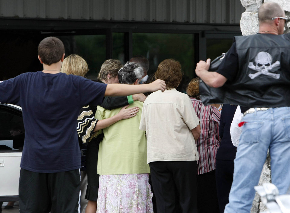 Photo - Mourners enter the Taylor Dawn Paschal-Placker funeral at Frist Baptist Church in Dewar, Okla., Friday, June 13, 2008. The funeral for the second of two girls who were mysteriously shot and killed on a country road was planned for later Friday (AP PHOTO/Stephen Pingry/Tulsa World)