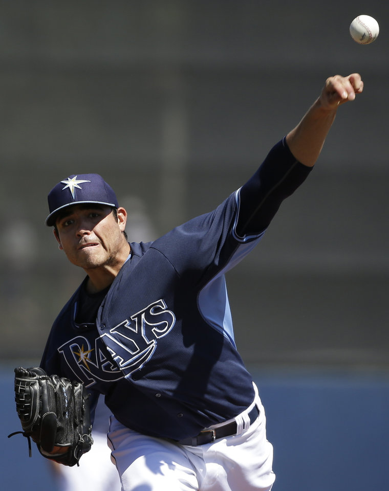 Photo - Tampa Bay Rays pitcher Matt Moore delivers a warm-up throw in the first inning an exhibition baseball game against the Philadelphia Phillies, Monday, March 3, 2014, in Port Charlotte, Fla. (AP Photo/Steven Senne)