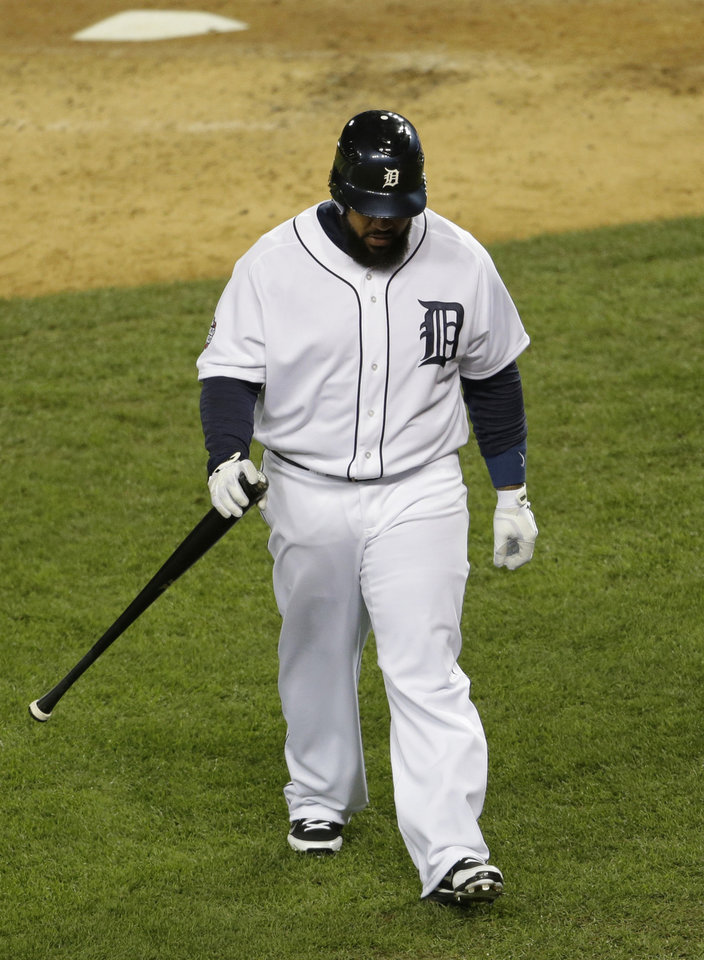Photo -   Detroit Tigers' Prince Fielder walks back to the dugout after striking out during the fourth inning of Game 3 of baseball's World Series against the San Francisco Giants Saturday, Oct. 27, 2012, in Detroit. (AP Photo/Patrick Semansky)