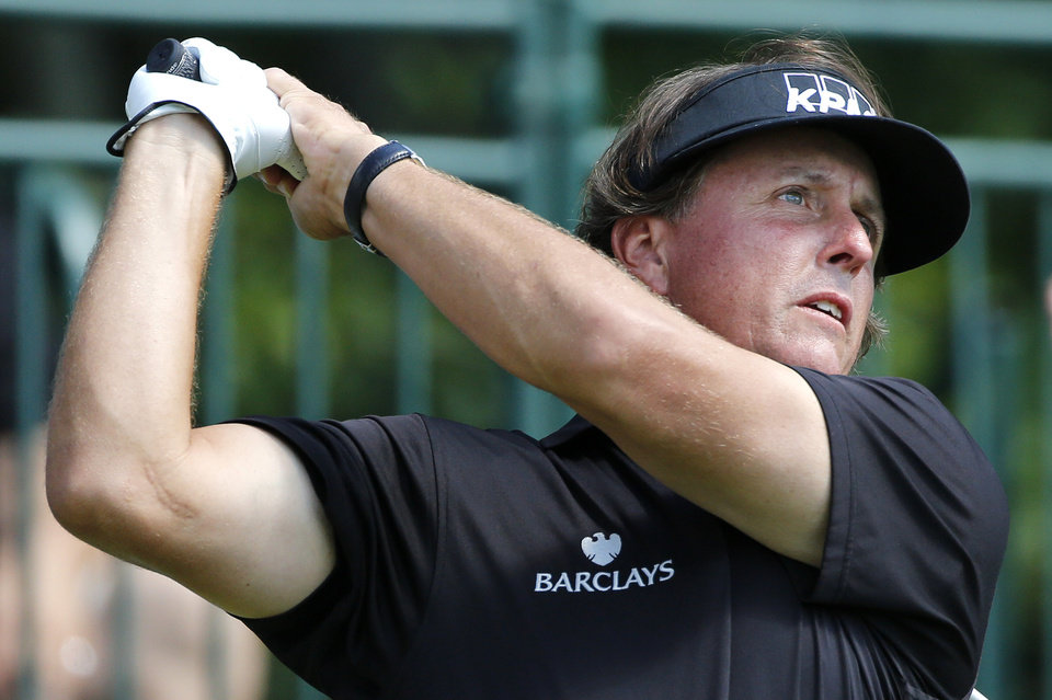Photo -   Phil Mickelson tees off on the first hole during the final round of the Deutsche Bank Championship PGA golf tournament at TPC Boston in Norton, Mass., Monday, Sept. 3, 2012. (AP Photo/Michael Dwyer)