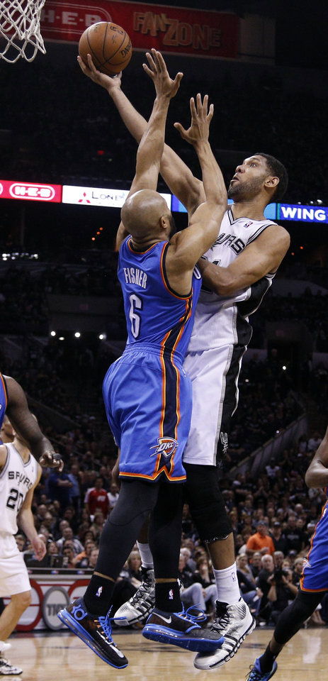 Photo - San Antonio's Tim Duncan (21) shoots a lay up as Oklahoma City's Derek Fisher (6) defends during Game 1 of the Western Conference Finals in the NBA playoffs between the Oklahoma City Thunder and the San Antonio Spurs at the AT&T Center in San Antonio, Monday, May 19, 2014. Photo by Sarah Phipps, The Oklahoman
