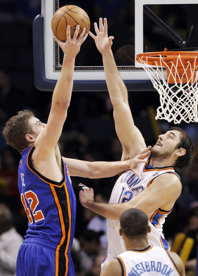 Oklahoma City's Nenad Krstic (12) defends David Lee (42) of New York during the NBA basketball game between the Oklahoma City Thunder and the New York Knicks at the Ford Center in Oklahoma City, January 11, 2010. Photo by Nate Billings, The Oklahoman