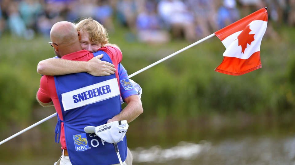 Photo - Brandt Snedeker, right, of the United States, hugs his caddie Scott Vail after winning the Canadian Open golf tournament at Glen Abbey in Oakville, Ontario, Sunday, July 28, 2013. (AP Photo/The Canadian Press, Nathan Denette)