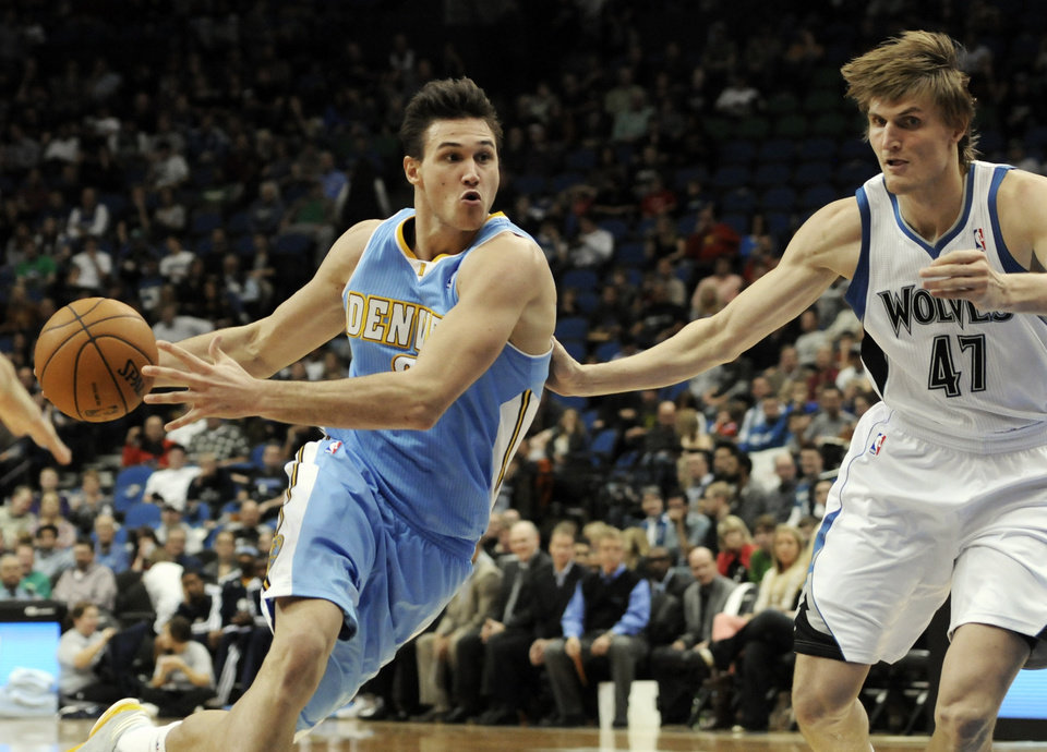 Photo -   Denver Nuggets' Danilo Gallinari, left, of Italy, drives around Minnesota Timberwolves' Andrei Kirilenko, of Russia, in the second half of an NBA basketball game on Wednesday, Nov. 21, 2012, in Minneapolis. The Nuggets won 101-94. Gallinari led his team with 19 points. (AP Photo/Jim Mone)