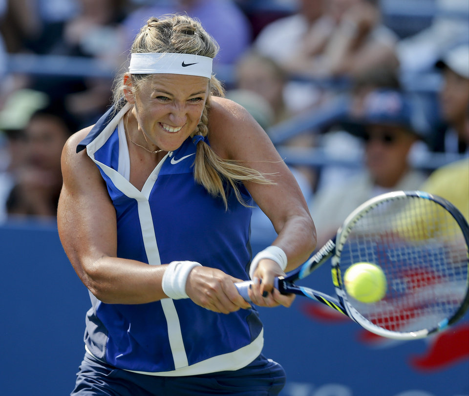 Photo - Victoria Azarenka, of Belarus, returns a shot against Misaki Doi, of Japan, during the first round of the 2014 U.S. Open tennis tournament, Tuesday, Aug. 26, 2014, in New York. (AP Photo/Jason DeCrow)