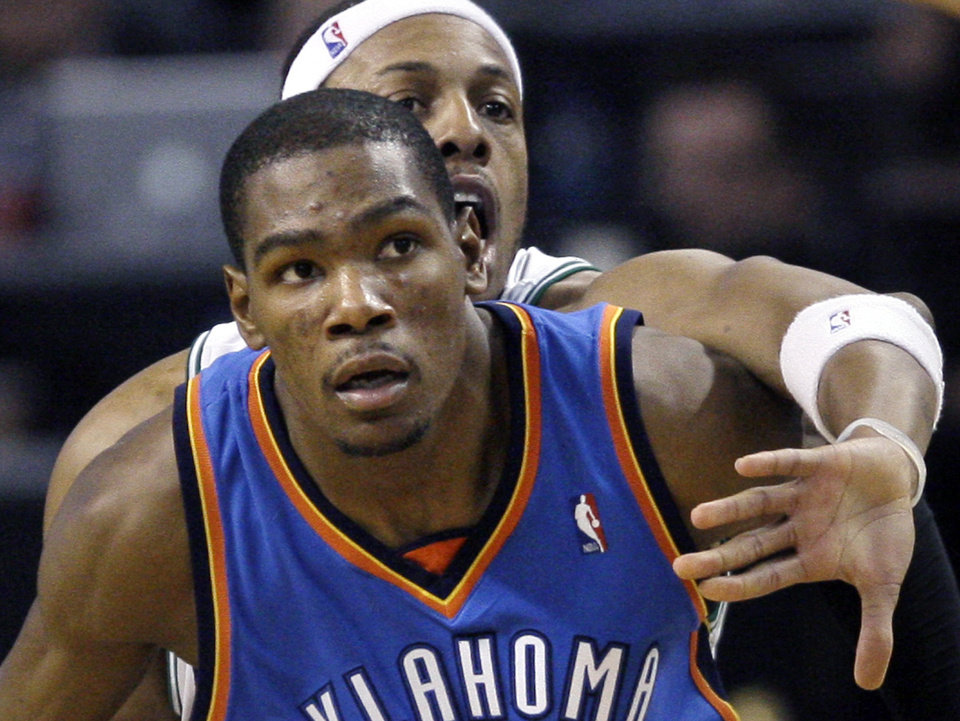 Boston Celtics' Paul Pierce, behind, tries to stop Oklahoma City Thunder's Kevin Durant from receiving a pass in the second half of an NBA basketball game in Boston Wednesday, March 31, 2010. The Thunder won 109-104. (AP Photo/Elise Amendola) ORG XMIT: MAEA110