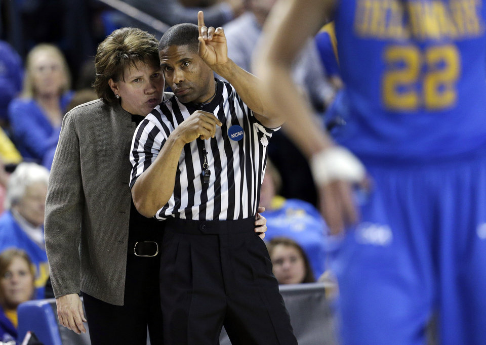 Delaware head coach Tina Martin, left, speaks with an official during a pause in play in the first half of a second-round game against North Carolina in the women's NCAA college basketball tournament in Newark, Del., Tuesday, March 26, 2013. (AP Photo/Patrick Semansky)