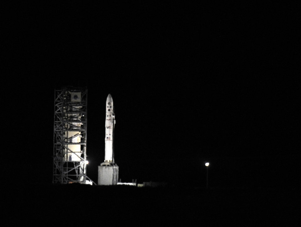 Photo - An unmanned Minotaur rocket that will carry NASA's newest robotic explorer, the LADEE spacecraft, which is charged with studying the lunar atmosphere and dust, sits on the launch pad at NASA's Wallops Flight Facility on Virginia's Eastern Shore on Friday, Sept. 6, 2013. (AP Photo/Eastern Shore News, Jay Diem)