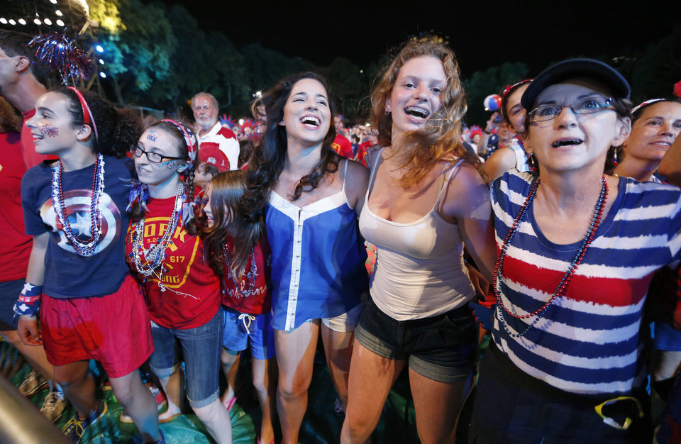 Photo - People dance to the Beach Boys during a concert at the Hatch Shell on the Esplanade in Boston, Thursday, July 3, 2014. The annual Boston Pops Fourth of July concert and fireworks show was moved up a day because of potential heavy rain ahead of Hurricane Arthur. (AP Photo/Michael Dwyer)