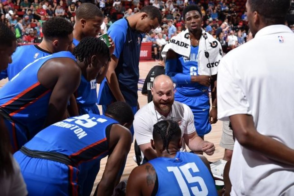 Photo -  New Thunder assistant Dave Bliss, center, coaches OKC's summer league team July 6 in Las Vegas. [David Dow/NBAE via Getty Images]