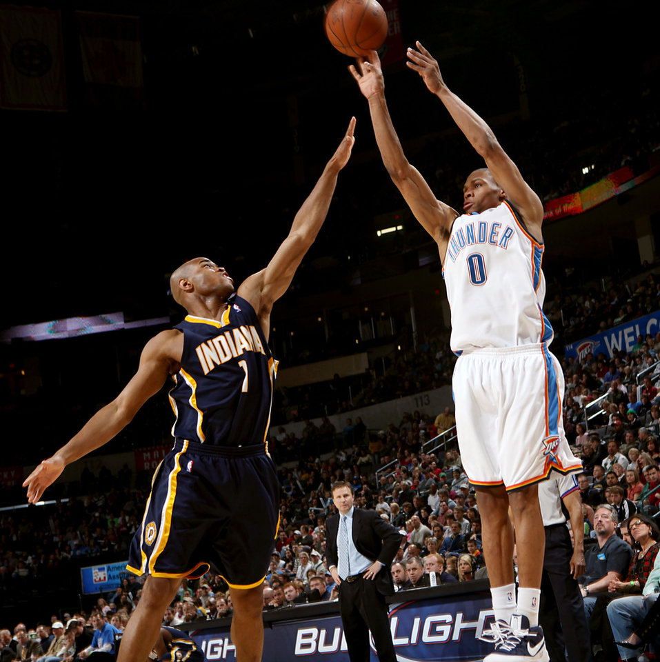 Photo - Oklahoma City's Russell Westbrook takes a shot over Indiana's Jarrett Jack during the NBA basketball game between the Indiana Pacers and the Oklahoma City Thunder at the Ford Center in Oklahoma City, Sunday, April 5, 2009. Photo by John Clanton, The Oklahoman ORG XMIT: KOD