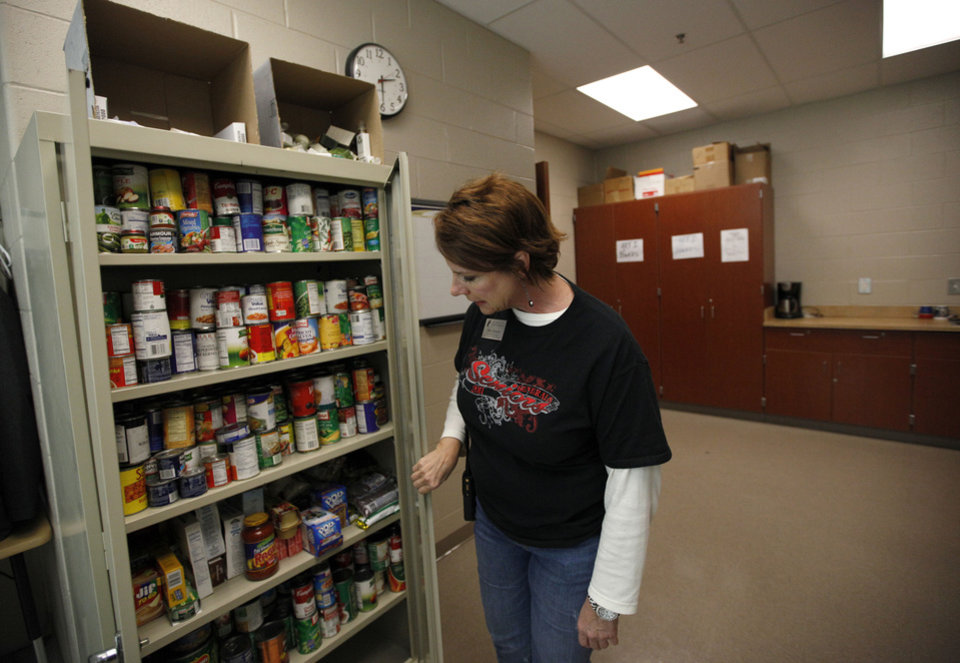 Mary Barrett, assistant principal at U.S. Grant High School, looks at a food pantry Friday at the high school in Oklahoma City.
