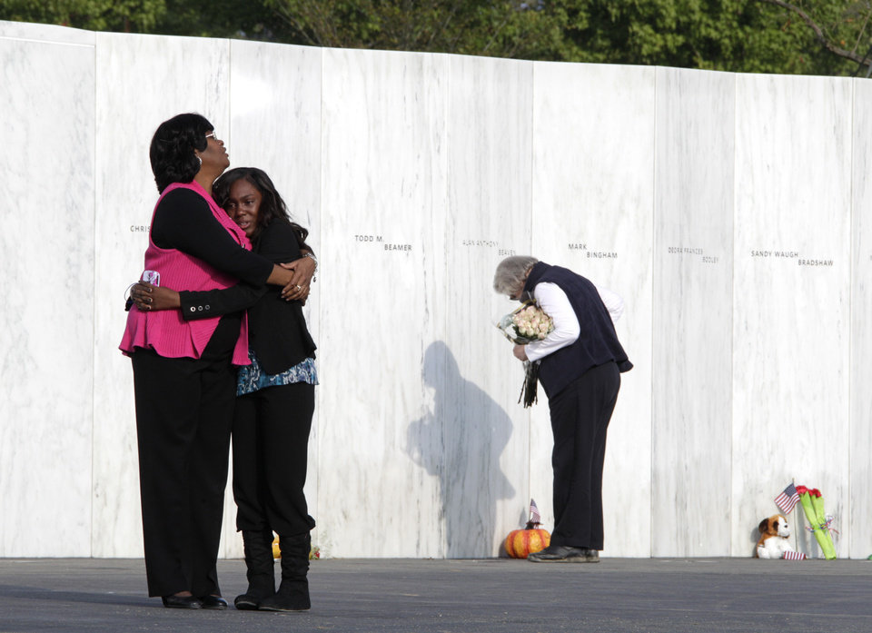 Visitors embrace in front of the Wall of Names near the crash site of Flight 93 in Shanksville, Pa. Sunday Sept. 11, 2011. (AP Photo/Amy Sancetta)