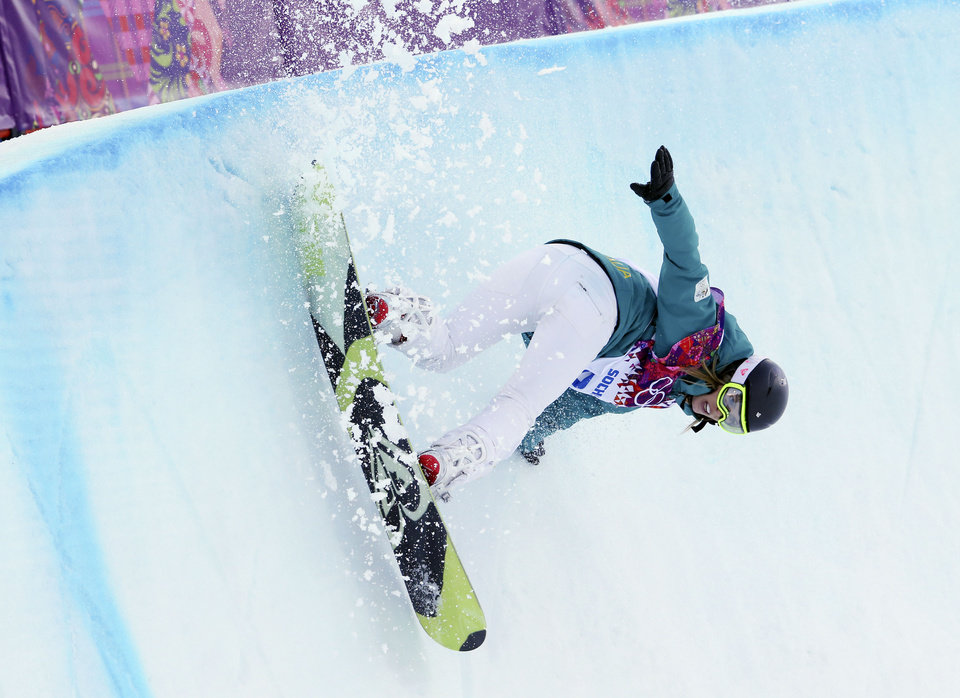 Photo - Australia's Torah Bright competes in the women's snowboard halfpipe qualifying at the Rosa Khutor Extreme Park, at the 2014 Winter Olympics, Wednesday, Feb. 12, 2014, in Krasnaya Polyana, Russia. (AP Photo/Sergei Grits)