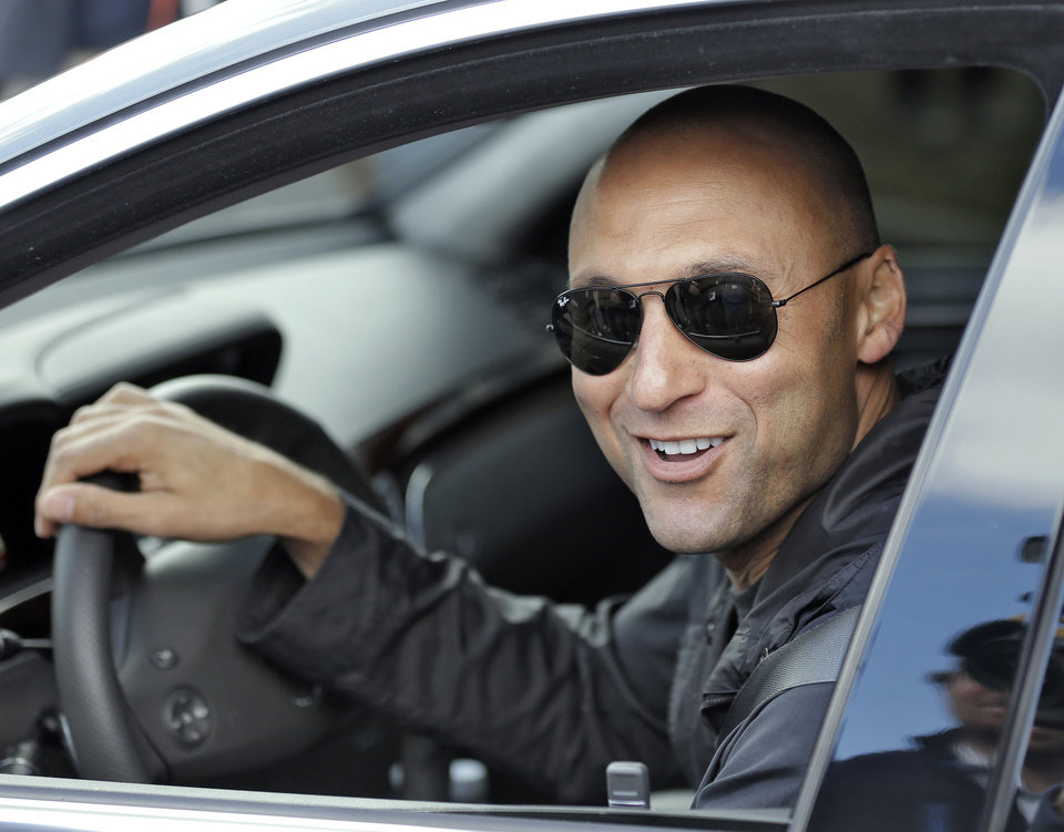 New York Yankees shortstop Derek Jeter smiles as he leaves after practicing at the baseball team's minor league facility Thursday, Feb. 13, 2014, in Tampa, Fla. Jeter announced that he will be retiring after the 2014 season. (AP Photo/Chris O'Meara)