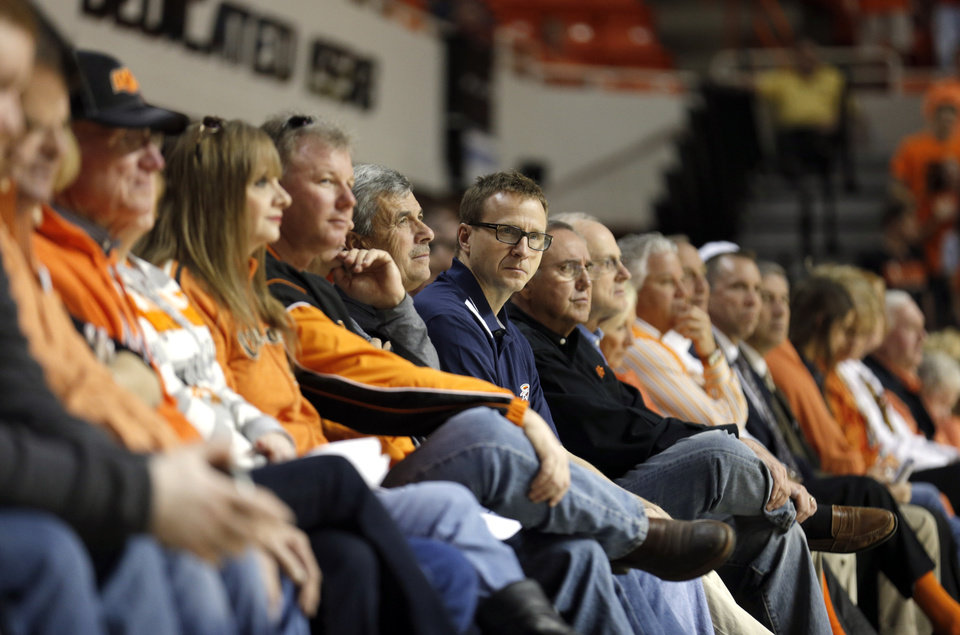 Photo - Oklahoma City Thunder head coach Scott Brooks watches game action during the men's college basketball game between Oklahoma State and Texas Tech at Gallagher-Iba Arena in Stillwater, Okla., Saturday, Feb. 22, 2014. OSU won 84-62. 