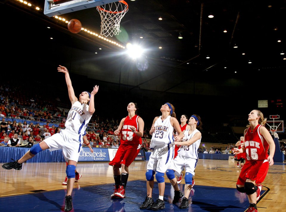 Photo - Newkirk's Kaylyn Pulley (11) shoots a layup during girls 2A semifinal between Howe and Newkirk at the State Fair Arena, Friday, March 13, 2009, in Oklahoma City. PHOTO BY SARAH PHIPPS, THE OKLAHOMAN