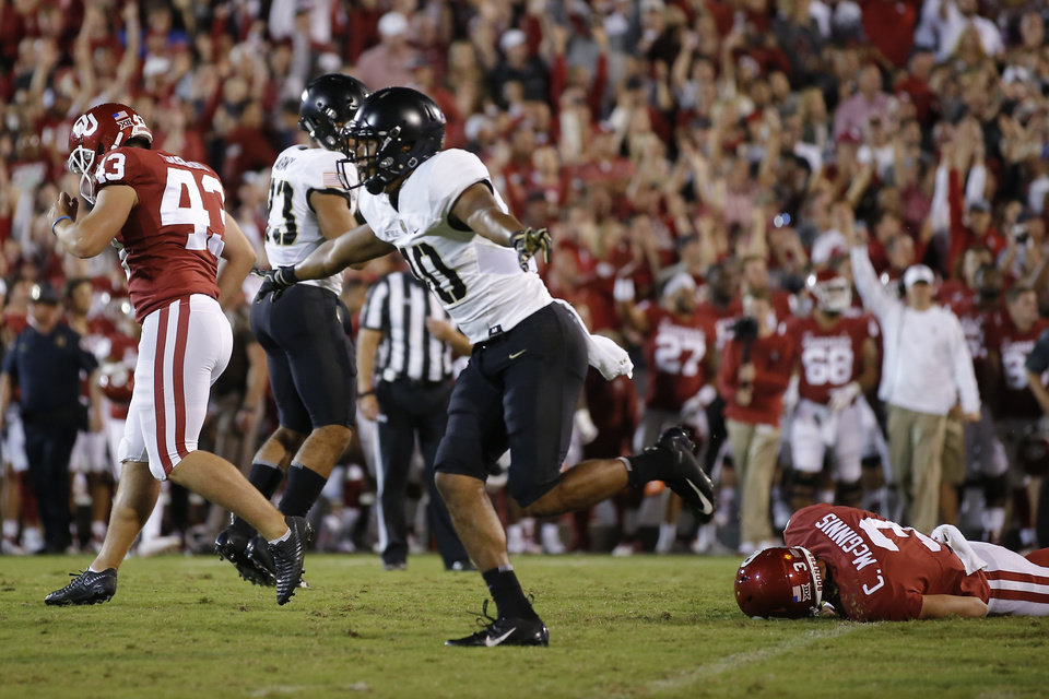 Photo - Army's Mike Reynolds (10) celebrates a missed field goal between Oklahoma's Austin Seibert (43) and Connor McGinnis (3) during a college football game between the University of Oklahoma Sooners (OU) and the Army Black Knights at Gaylord Family-Oklahoma Memorial Stadium in Norman, Okla., Saturday, Sept. 22, 2018. Photo by Bryan Terry, The Oklahoman