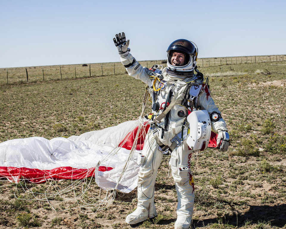 Photo -   In this photo provided by Red Bull Stratos, Pilot Felix Baumgartner of Austria celebrates after successfully completing the final manned flight for Red Bull Stratos in Roswell, N.M., Sunday, Oct. 14, 2012. Baumgartner came down safely in the eastern New Mexico desert minutes about nine minutes after jumping from his capsule 128,097 feet, or roughly 24 miles, above Earth. (AP Photo/Red Bull Stratos, Balazs Gardi)