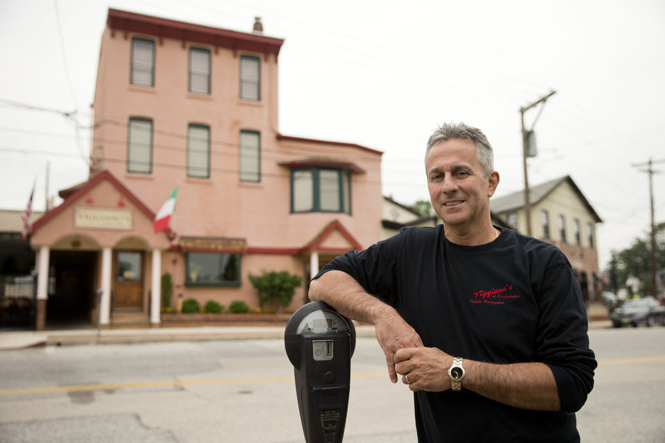 Photo - In this Thursday, May 29, 2014 photo, Mark Viggiano, owner of Viggiano's Italian BYOB, in background, poses for a portrait, in Conshohocken, Pa. Viggiano lost his restaurant during the recession and reopened it about a year ago. (AP Photo/Matt Rourke)