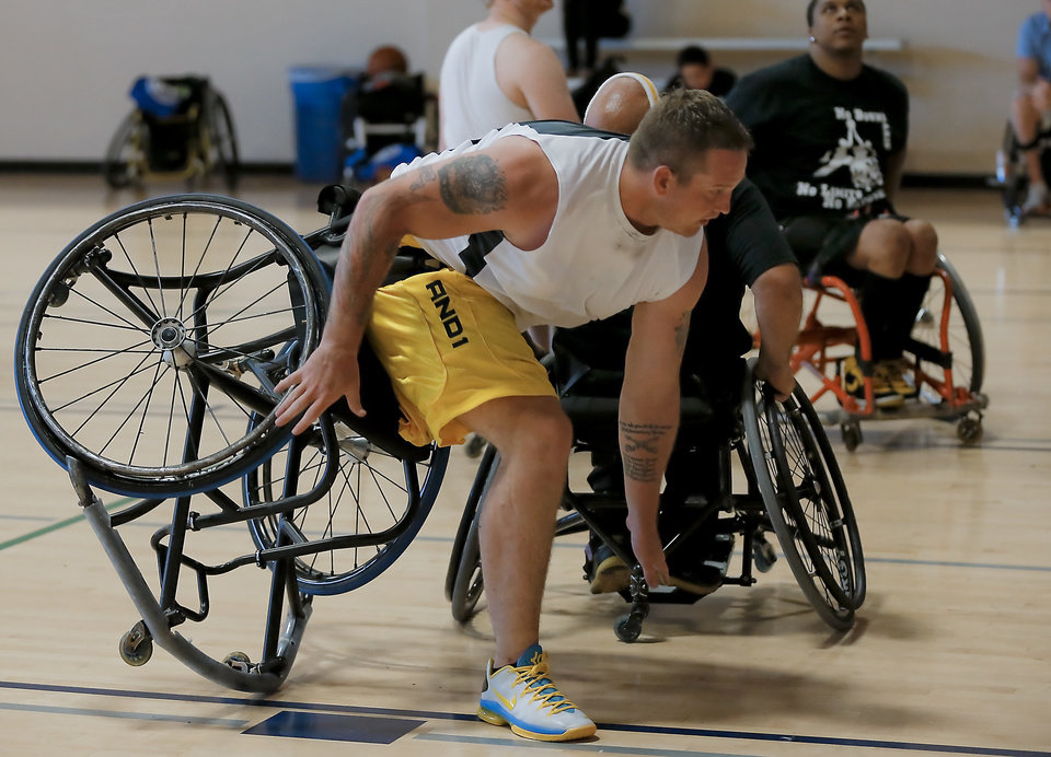 Brian Wofford stumbles in his chair while competing in the three on three basketball game during the Endeavor Games at the University of Central Oklahoma on Friday, June 7, 2013 in Edmond, Okla. Photo by Chris Landsberger, The Oklahoman