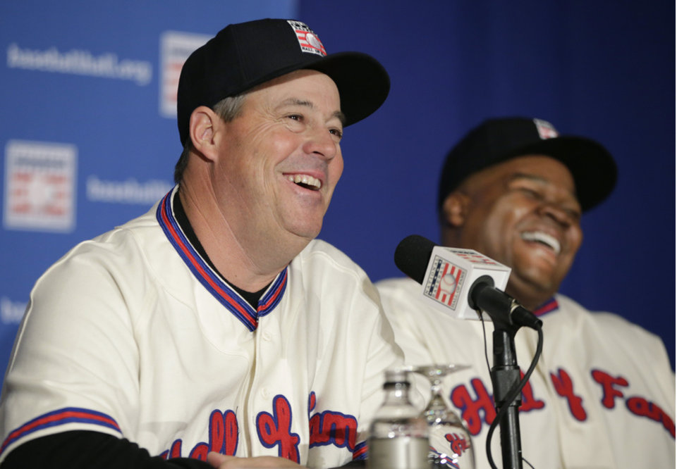 Photo - Former Atlanta Braves pitcher Greg Maddux, left, and former Chicago White Sox slugger Frank Thomas laugh during a press conference announcing their election into the 2014 Baseball Hall of Fame class, Thursday, Jan. 9, 2014, in New York. Former Atlanta Braves pitcher Tom Glavine was also elected into the Hall of Fame. (AP Photo/Kathy Willens)