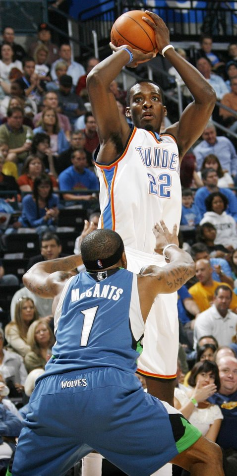 Photo - FIRST REGULAR SEASON WIN: Oklahoma City's Jeff Green takes a shot over Rashad McCants of Minnesota during the NBA basketball game between the Oklahoma City Thunder and the Minnesota Timberwolves at the Ford Center in Oklahoma City, Sunday, Nov. 2, 2008. BY NATE BILLINGS, THE OKLAHOMAN  ORG XMIT: KOD