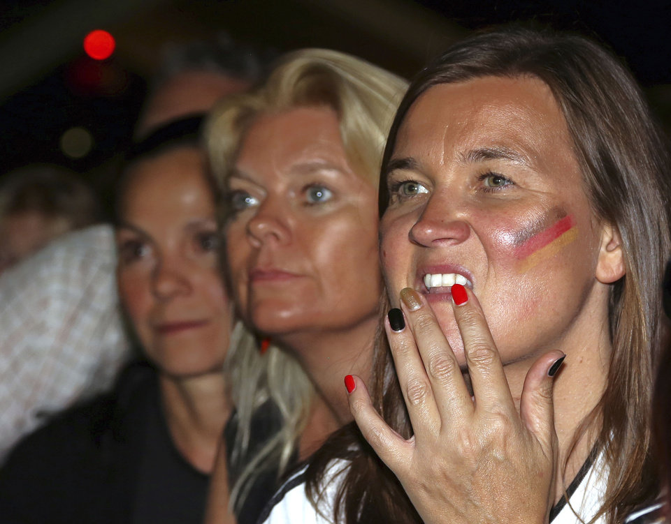 Photo - German soccer watch their team's World Cup final against Argentina in Rio de Janeiro, Brazil, at the German Embassy in Ankara, Turkey, early Monday, July 14, 2014. Germany won the final by 1-0 .(AP Photo/Burhan Ozbilici)